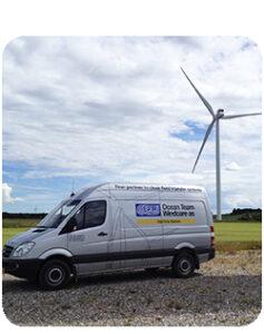 Ocean Team van parked next to a windmill.
